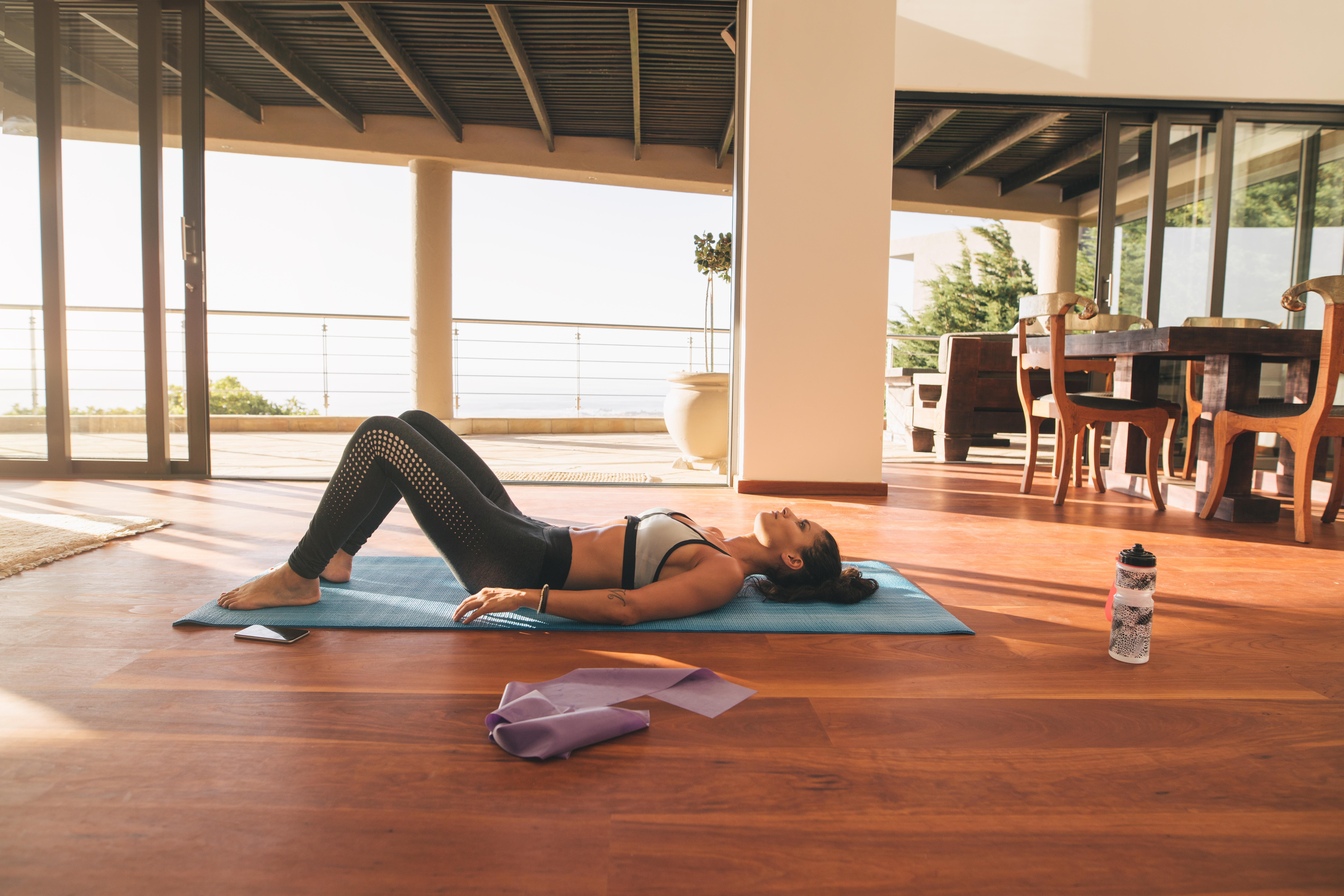 featured-image-female-relaxing-on-floor-after-workout