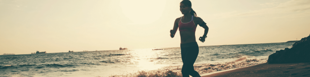 fit-woman-running-on-the-beach