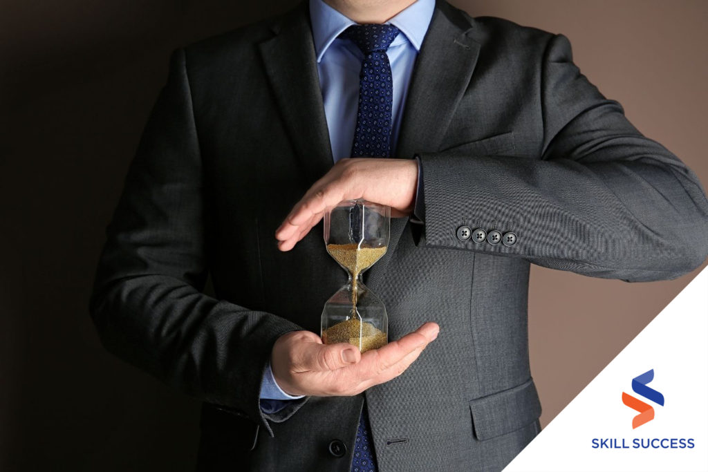 dentist-wearing-suit-and-tie-holding-an-hour-glass